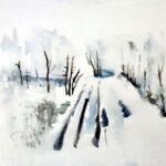 Landschaft mir Fahrspuren im Schnee